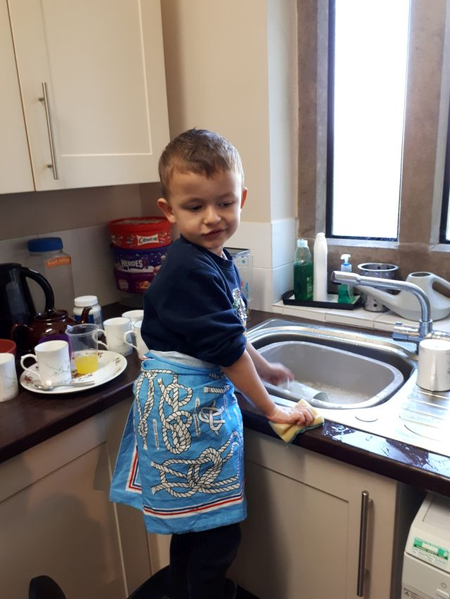 Charlie helping with Messy Church Washing Up. Feb 2019.